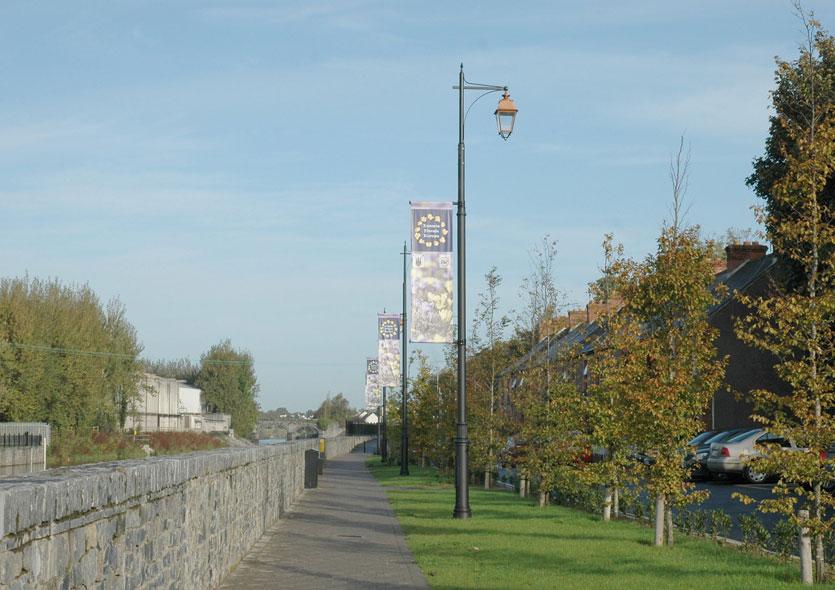 Daytime Photo of Lights along Riverbank